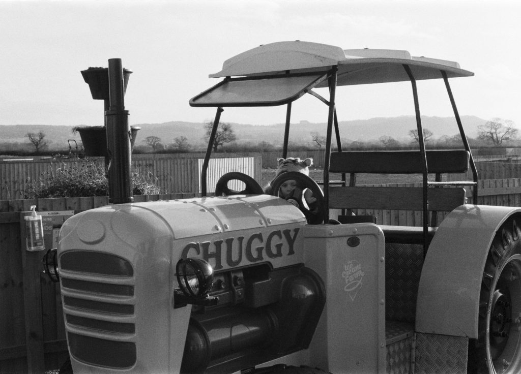 Black and white film photograph of tractor shot at Wheelock on ILFORD Dleta 400 film