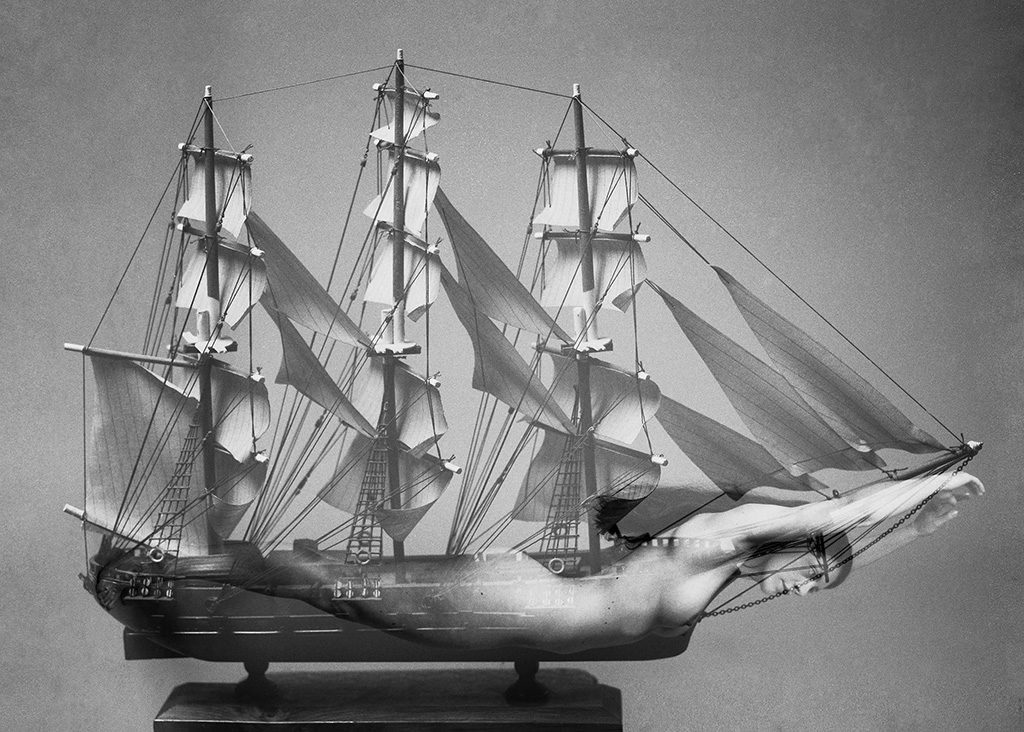 Black and white double exposure of ship and female nude by Lucy Ridges. Shot on ILFORD FP4 film