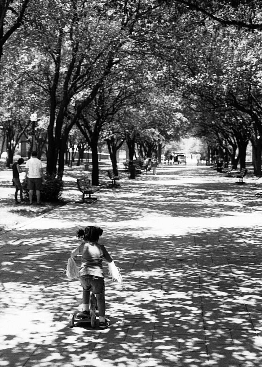 Black and shite film photo of child riding a bike for the first time for #fridayfavourites #pride