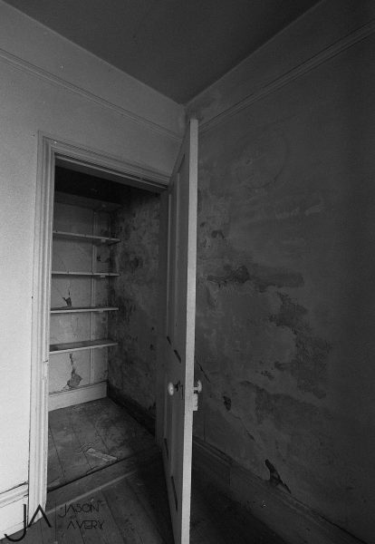 Black and white photo pof interior of old building shot on expired HP5 black and white film by Jason Avery