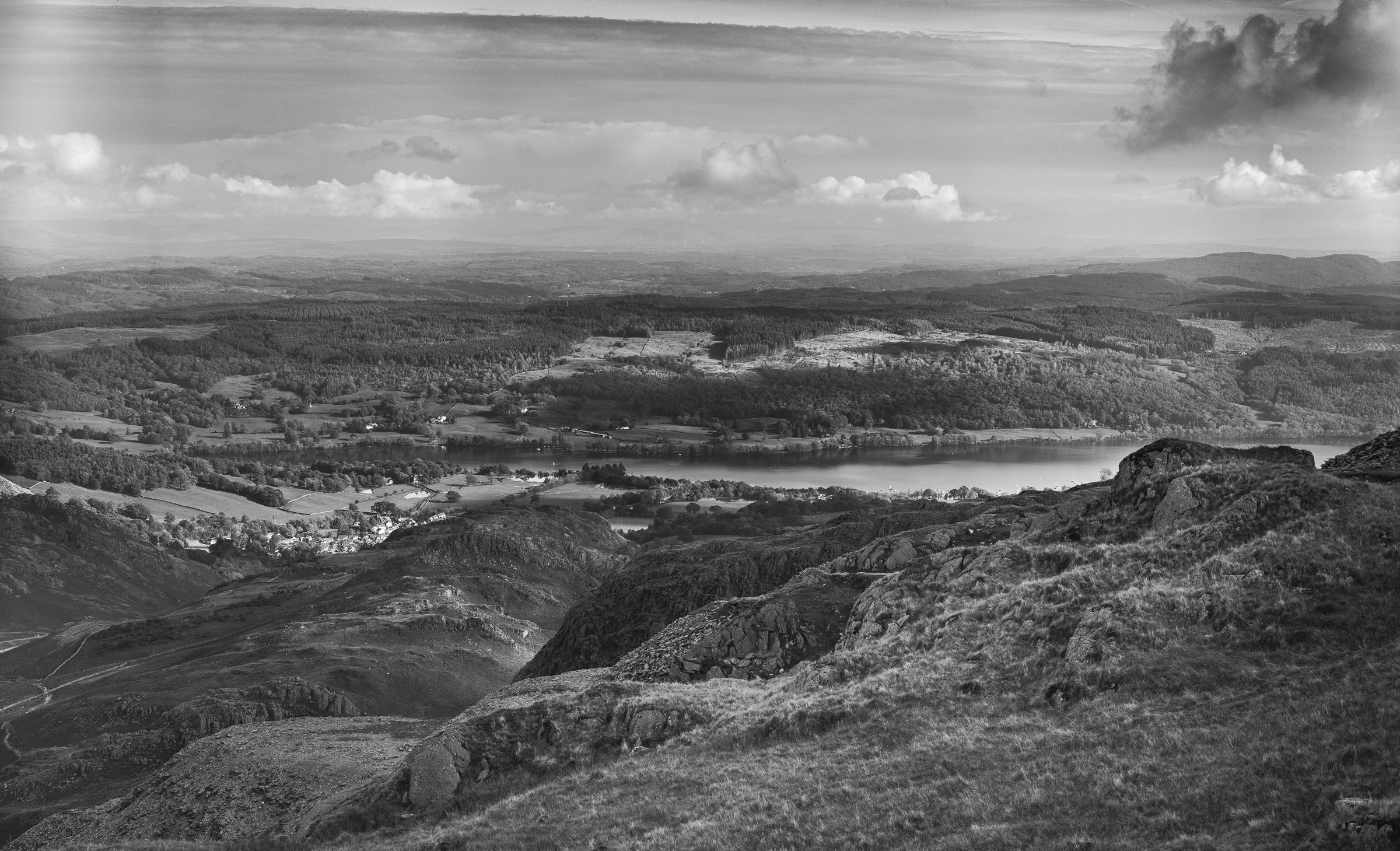 View over Coniston (with unknown light leaks shot on ILFORD FP4+ black and white film by John Whitmore