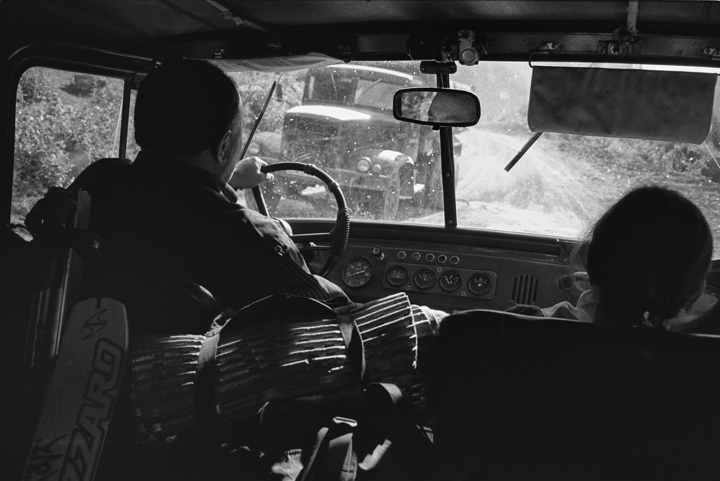 Hitching a ride back from the mountains with locals. Svaneti, Georgia (Caucasus), June 2012. Contax T3, B+W yellow filter and Ilford HP5+ (in HC-110). Nikon Coolscan 8000ED scan.