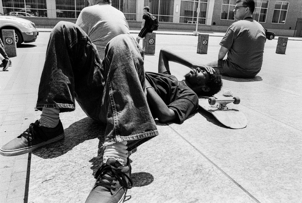@tmway84 Skateboarder Resting in the Summer Sun Camera: Nikon F5 & 28mm Film: #ilfordphoto #35mm HP5 400iso & #Kodak D76 1+1(11min) Location: #Raleigh, NC USA #believeinfilm #filmphotography #street #fridayfavourites
