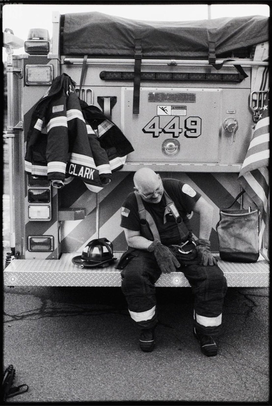 "@MattAngleyPhoto ""Smoked"" Fireman Scott Clark takes a break on the back bumper of a fire engine at a fire scene Camera Canon AE-1 + Canon FD 50mm f/1.4 🎞 Ilford Delta 3200 #ilfordphoto #fridayfavourites #specialistfilm #filmphotography #believeinfilm #delta3200 #ilfordfilm #blackandwhitephotography"