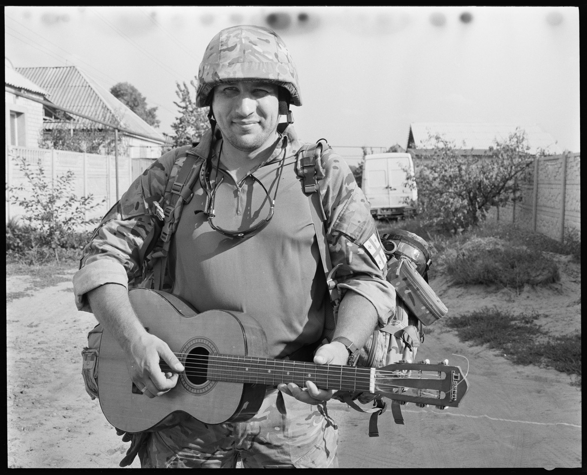 Soldier with guitar by Brett Hillyard on ILFORD black and white HP5+ Film