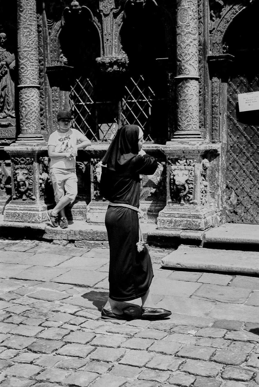 @hejrevell Young Nun entering 17th Century Boom Chapel in Lviv Ukraine. ILFORD PanF Plus, Leica M7   50mm Summicron Lens. #ilfordphoto @ILFORDPhoto #fridayfavourites #Leica #LeicaCameraUSA