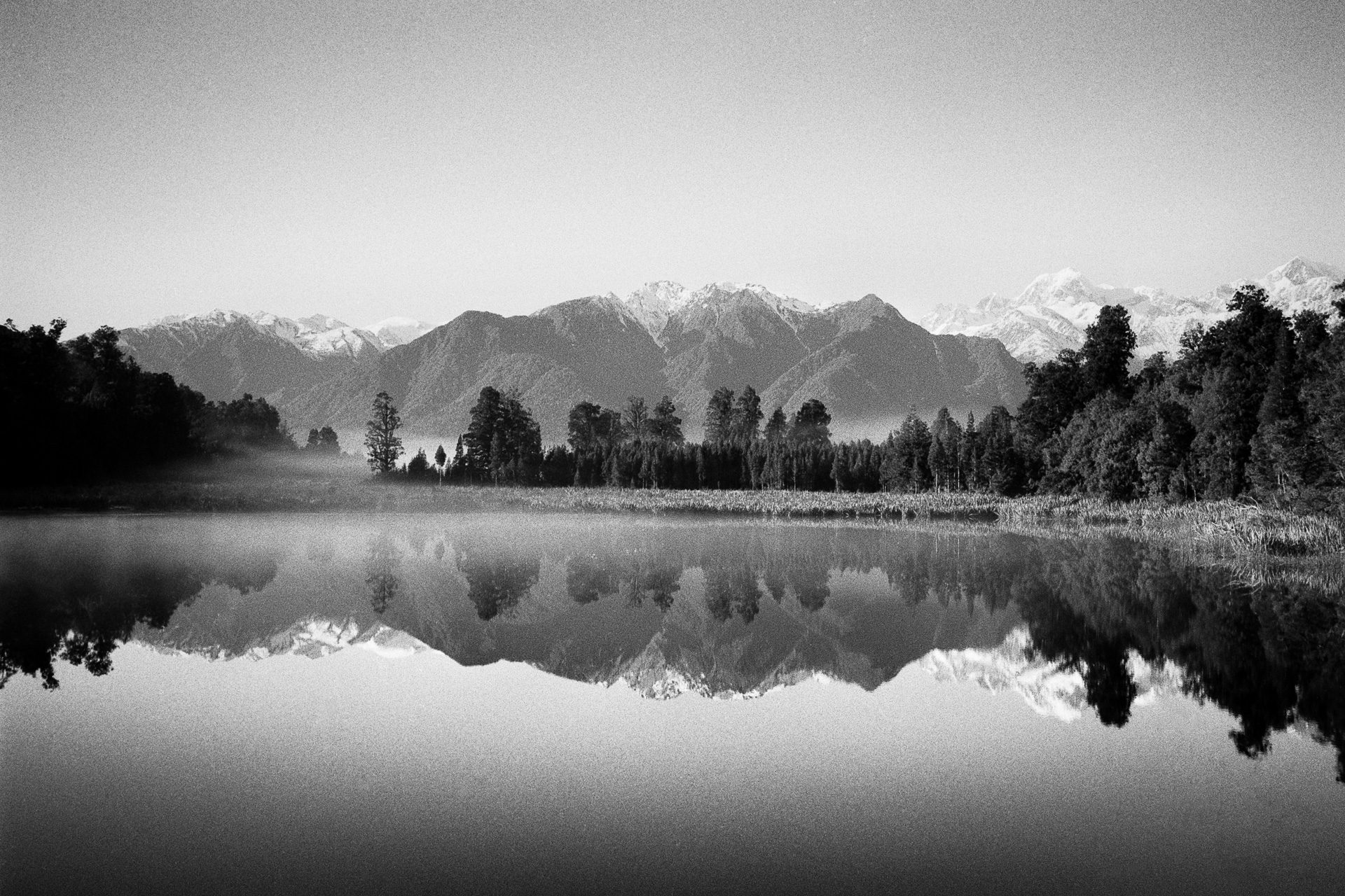 @paulasmithphoto Lake Matheson, New Zealand taken on my travels. Shot on @ILFORDPhoto Delta 100, with Leica MP & 35mm Summicron developed rodinal 1+25 9mins. #ilfordphoto #fridayfavourites #shotondelta100
