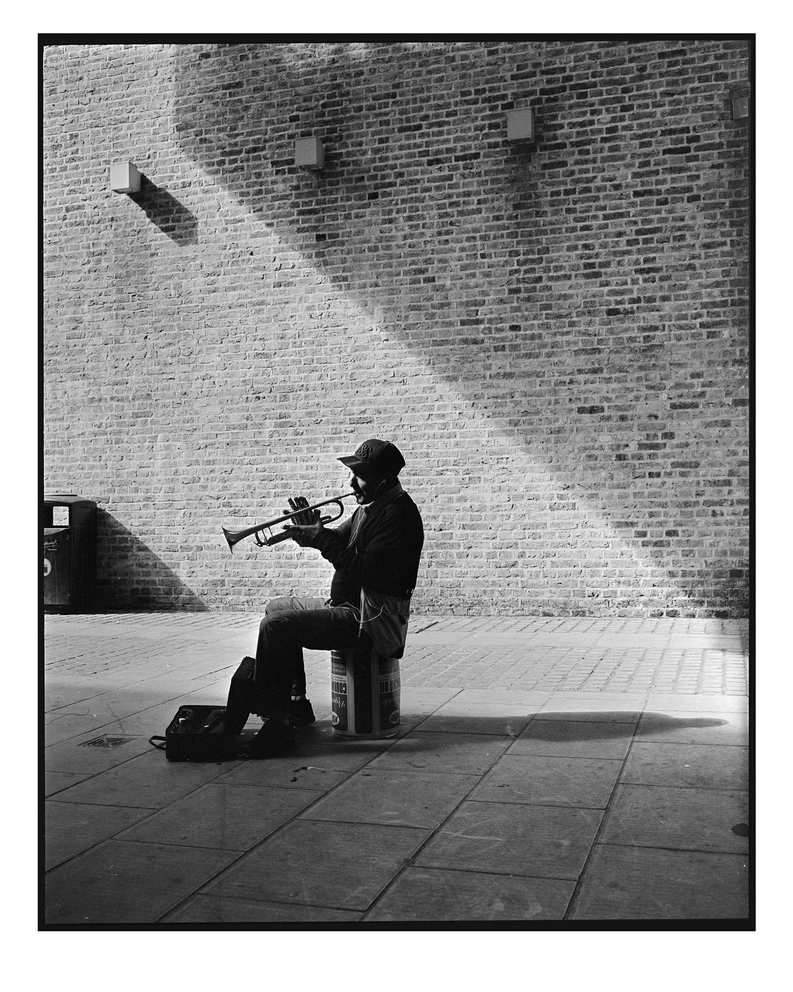 Street performer by Brett Hillyard on ILFORD black and white HP5+ Film