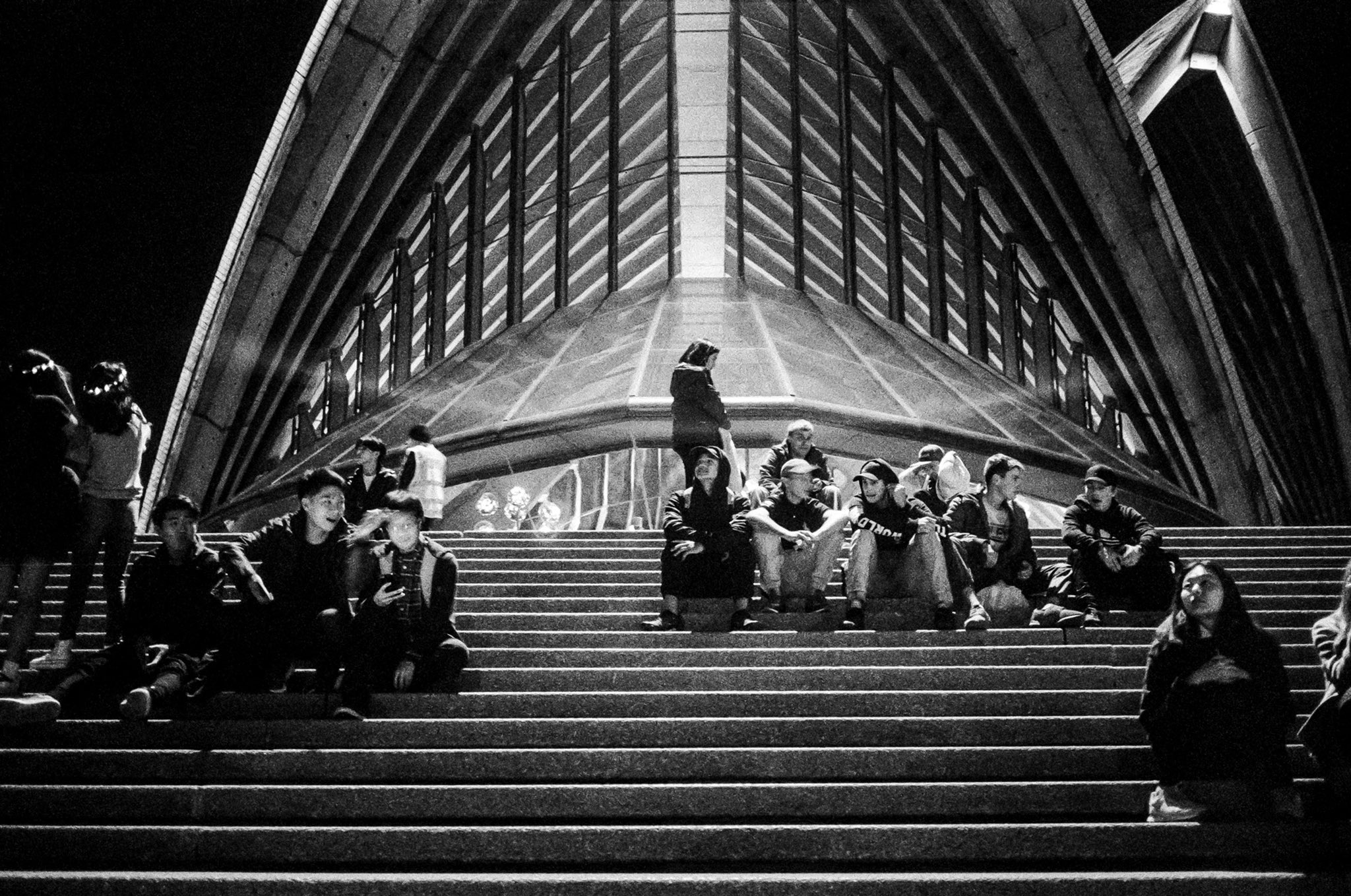 @billthoo Replying to @ILFORDPhoto Steps to humans are like reefs to fish. We are drawn to gather there. Sydney. May 2018. @ILFORDPhoto #delta3200. #M4 + #Voigtlander 35/2.5. #filmpeople #fridayfavourites #ilfordphoto #shootfilmbenice #believeinfilm #filmphotography #leica #ilovesydney #newsouthwales