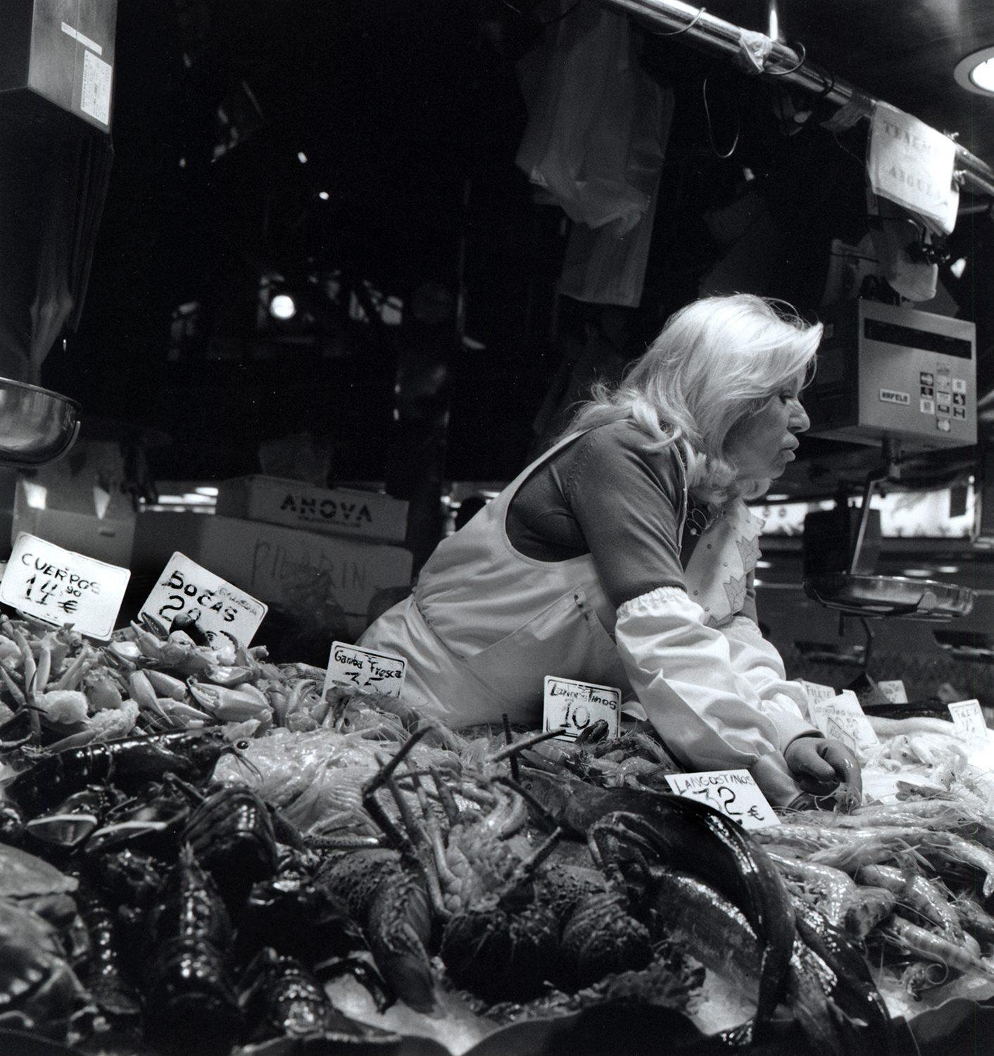 Lady serving in la boqueria fish market, Barcelona, Spain shot on ILFORD black and white film by Keith Moss
