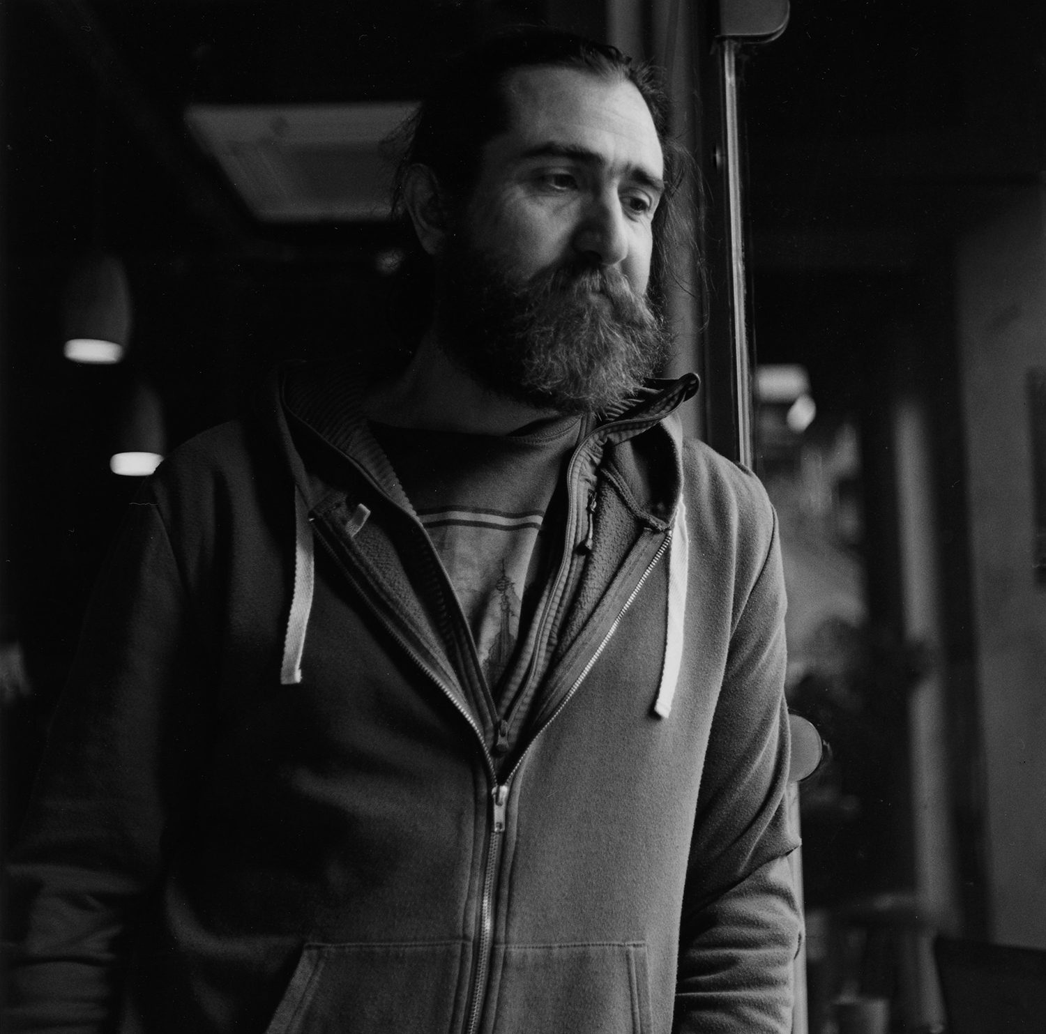 Portrait of a man in a cafe shot on ILFORD black and white film by Keith Moss