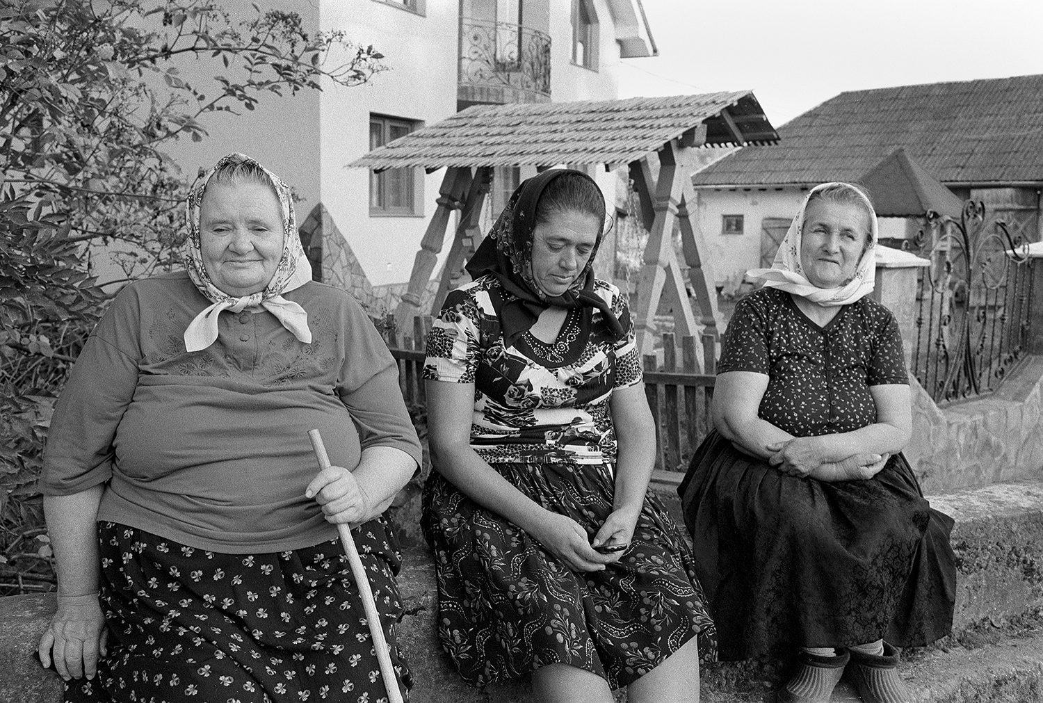 Street photo of three ladys in breb maremures Romania shot on ILFORD black and white film by Keith Moss