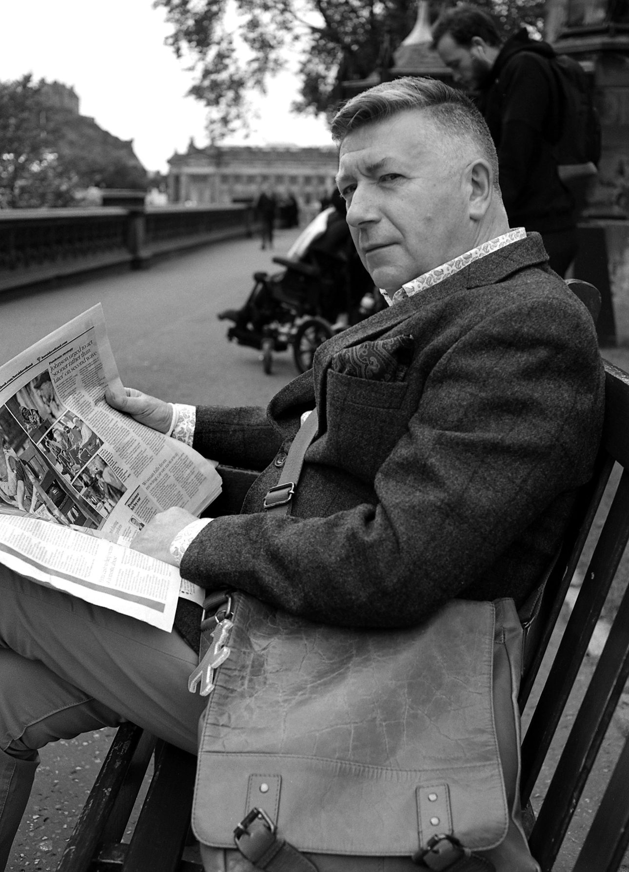 portrait of man reeding paprt in Edinburgh shot on ILFORD black and white film by Keith Moss