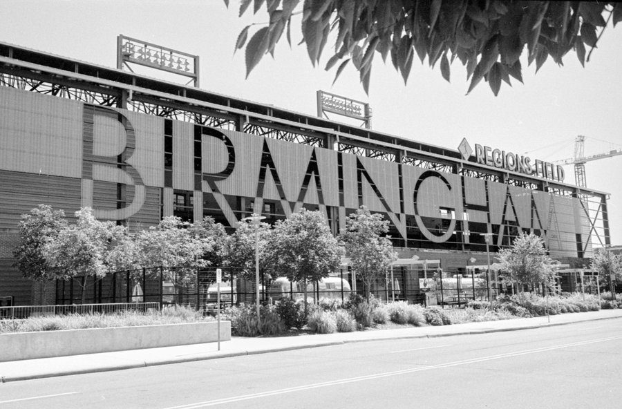 @bsanfordjr Replying to @ILFORDPhoto Regions Field in Birmingham, AL opened in 2013 as part of ongoing downtown redevelopment efforts. The facade is visible to motorists traveling through the city on I-65. Seen here on HP5+ and is lit by colorful lights at night. #ilfordphoto #fridayfavourites #sightseeing