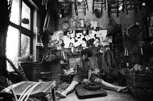 Linda Lemieux, a basket maker, cutting rushes in Somerset from a coracle she built herself on 09 June 2020 and weaving a basket in her workshop in Devon on 31 May 2020 Using Olympus OM-40 Program with XP2 Super and Zuiko 21 mm/f3.5 lens.
