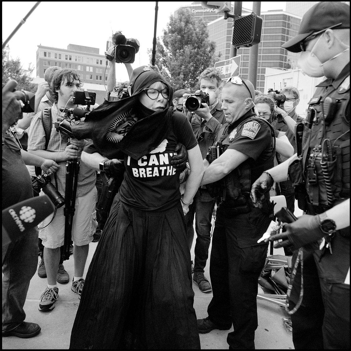 The arrest of Sheila Buck, at Donald Trump's rally. Tulsa, OK. Ilford Delta 400.