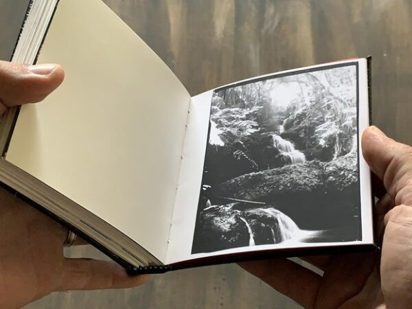 Mike Caputo making a photobook with darkroom prints