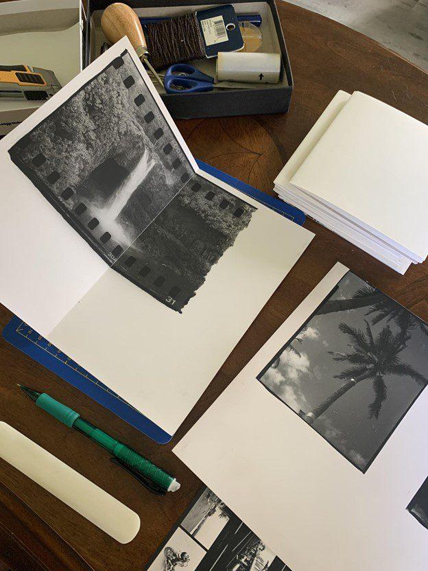 Mike Caputo making a photobook with darkroom prints