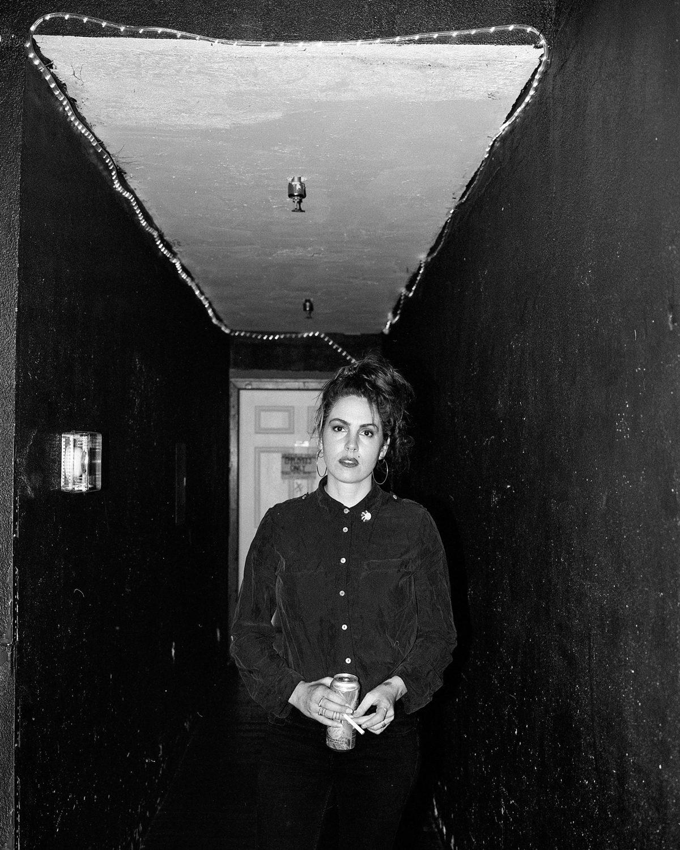 Emma Ruth Rundle, 2017. Vaudeville Mews, Des Moines, IA. Ilford Hp5 @ 400. Mamiya 7ii/80mm lens. Ilfotec HC.