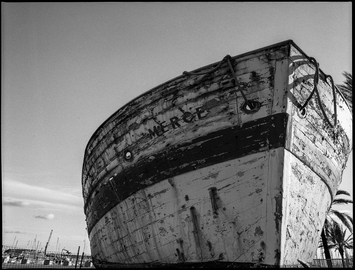 @rrafols · 1h One of my first outings with the #Pentax67 in my hometown. It was an old fishing boat that was later - very unfortunately - dismantled. #ilfordphoto #fridayfavourites #filmmemories #vilanovailageltru Also one of the first films I self-developed at home Smiling face with sunglasses (#HP5 & ilfosol)