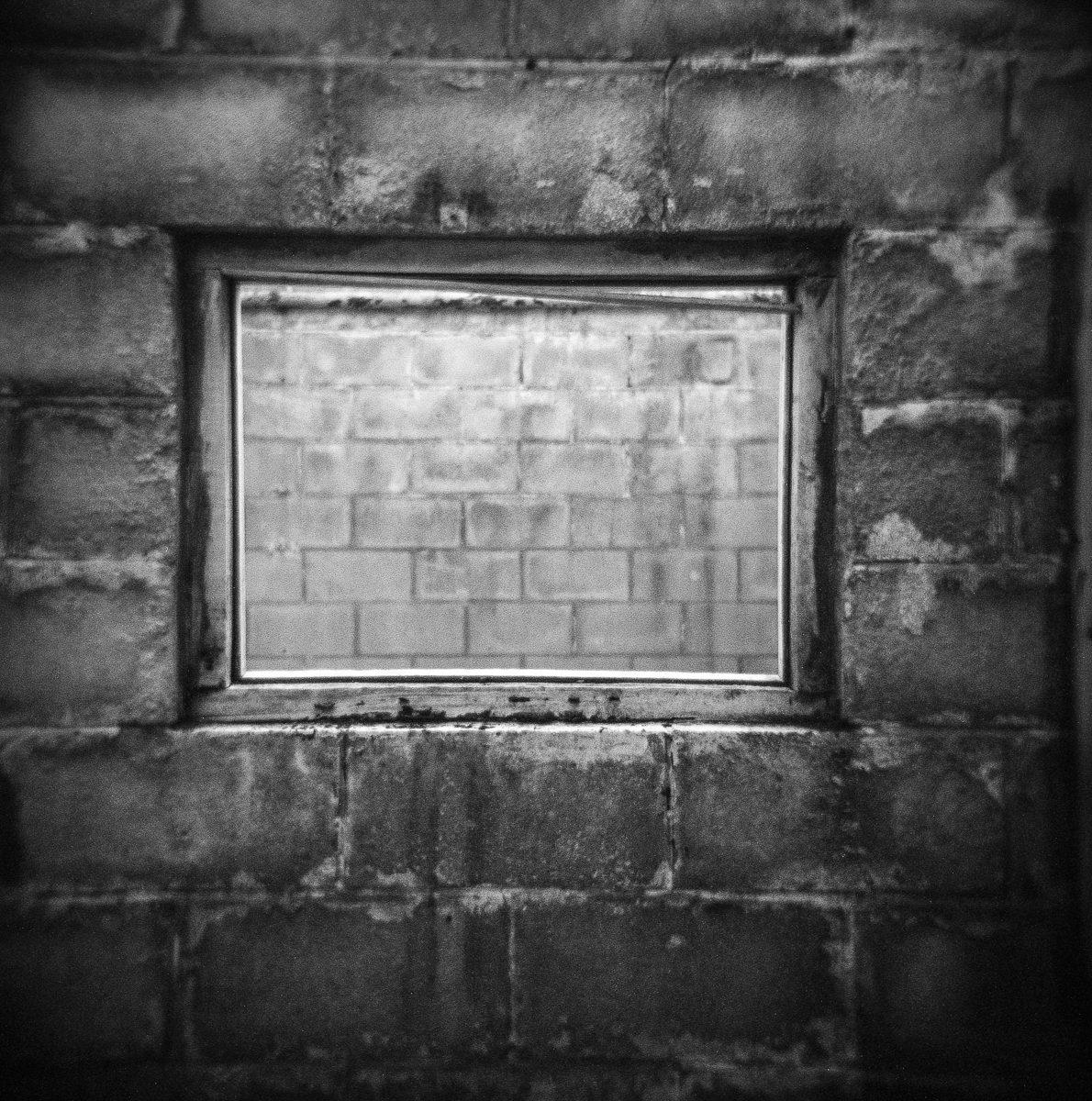 """@timdobbsphoto """"Through the window"""" .. Holga 120GN on ilford HP4 for #concretefilm #fridayfavourites #believeinfilm #Wales @ILFORDPhoto"""