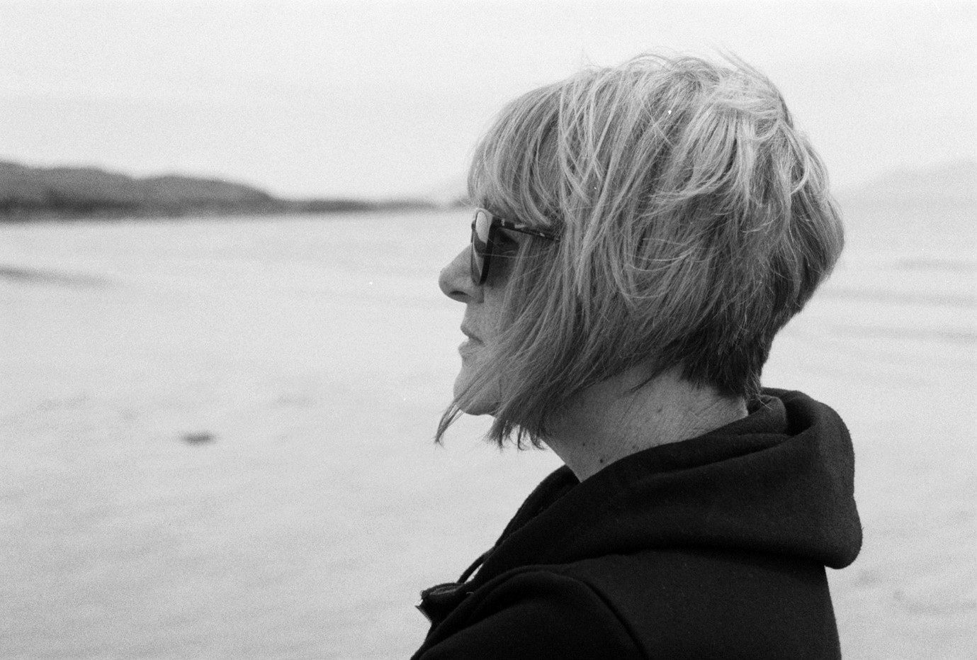 My beautiful mother on Aberffraw beach on Anglesey, she didn't realise I was taking the photo. (Sorry Mam!) Shot on FP4.