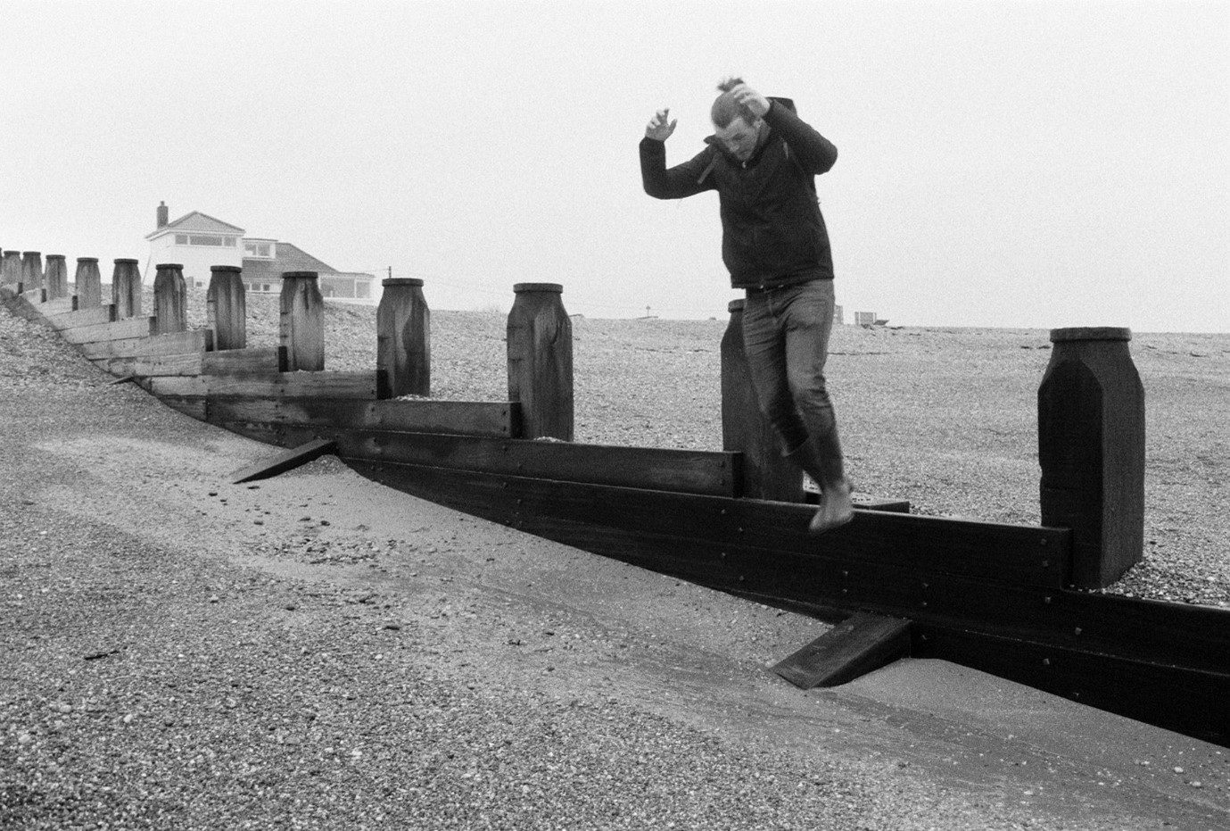 My boyfriend James on camber sands beach, shot on FP4.