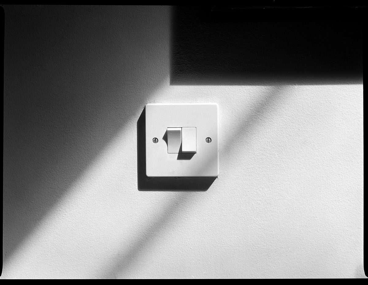 Black and white image of light switch show on ILFORD ORTHO PLUS film by Riger Lowe