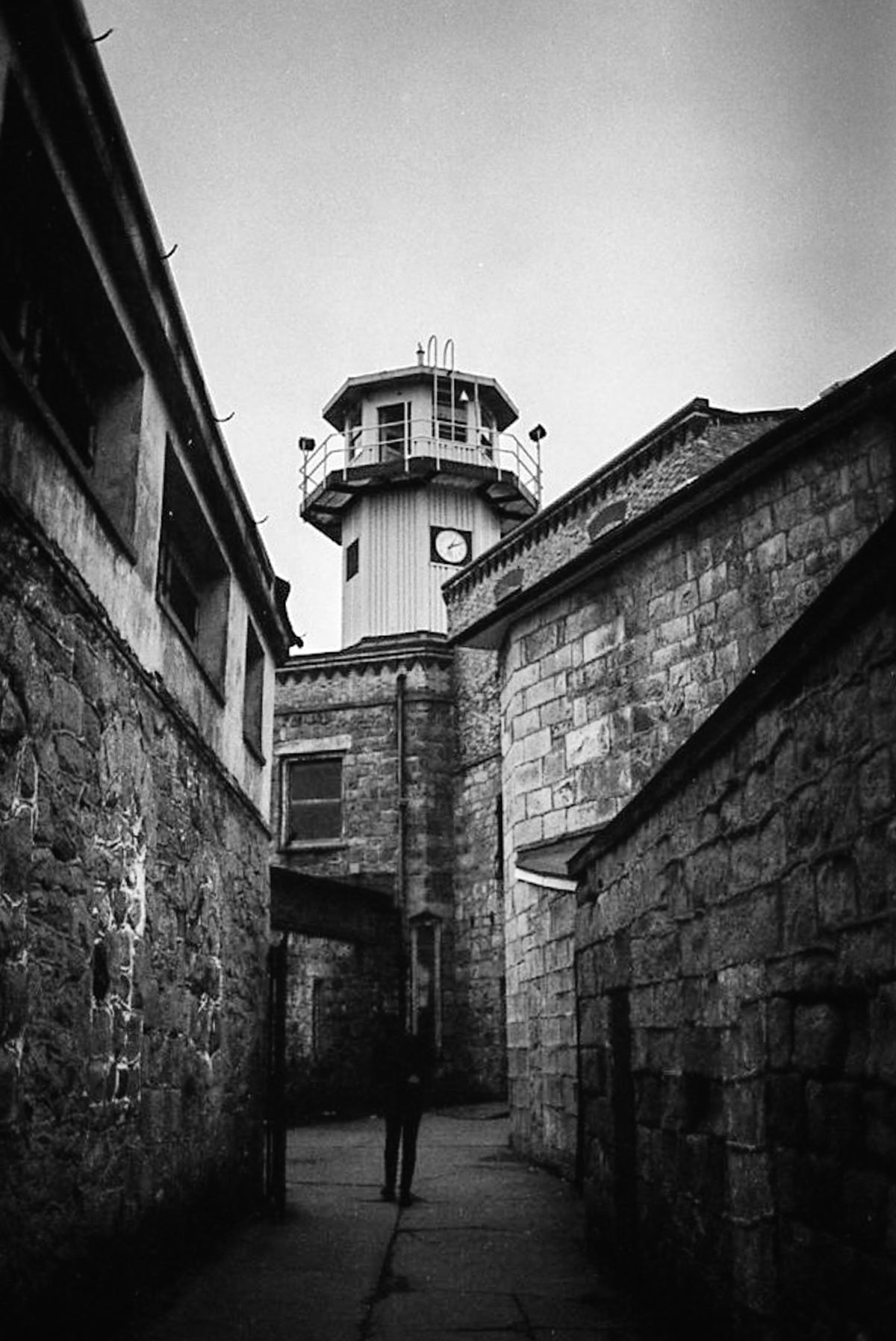 Another opportunity to photograph a shadowy subject near the guard tower. Even if you don't believe in ghosts, a haunting presence is felt everywhere you go here.